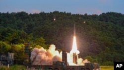 In this photo provided by South Korea Defense Ministry, a Hyunmoo II ballistic missile is fired during an exercise at an undisclosed location in South Korea, Sept. 4, 2017.
