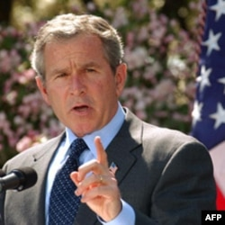 President Bush speaks in the Rose Garden of the White House in 2003