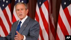 FILE - President George W. Bush makes remarks on comprehensive immigration reform in the Eisenhower Executive Office Building at the White House compound in Washington, June 26, 2007.