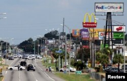 Police vehicles block access to part of Airline Highway after a fatal shooting of police officers in Baton Rouge, Louisiana; Sunday July 17, 2016.