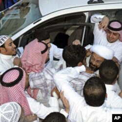Saudi Shi'ite cleric Tawfiq al-Amir (R) greets supporters in Al-Ahsa, Mar 6 2011, after his release from prison. He was arrested for calling for a constitutional monarchy and a fight against corruption, witnesses and human rights activists said