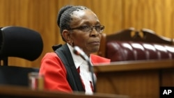 Presiding Judge Thokozile Masipa listens to arguments at the end of the fourth day of sentencing proceedings for Oscar Pistroius in the high court in Pretoria, South Africa, Oct. 16, 2014.