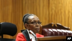 FILE - Presiding Judge Thokozile Masipa listens to arguments at the end of the fourth day of sentencing proceedings for Oscar Pistroius in the high court in Pretoria, South Africa, Oct. 16, 2014.