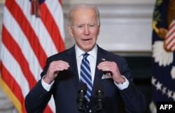 រូបឯកសារ៖ ប្រធានាធិបតីសហរដ្ឋអាមេរិកលោក Joe Biden ថ្លែងសុន្ទរកថាស្តីអំពីការប្រែប្រួលអាកាសធាតុ នៅសេតវិមានក្នុងរដ្ឋធានីវ៉ាស៊ីនតោន កាលពីថ្ងៃទី២៧ ខែមករា ឆ្នាំ២០២១។