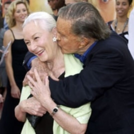 """Actor Cliff Robertson gives a kiss to actress Rosemary Harris at the premiere of """"Spider-Man 2"""" in Los Angeles in 2004"""