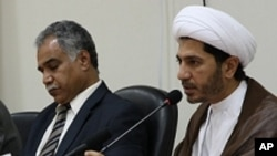 File - Opposition leaders Radhi Mohsen al-Mosawi (L) and Sheikh Ali Salman speak at a joint press conference in Umm Al Hassam, Bahrain.