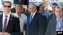 Israeli Prime Minister and Likud party's candidate running for general elections, Benjamin Netanyahu is surrounded by bodyguards during his visit in Har Homa, an Israeli settlement neighborhood of annexed east Jerusalem, March 16, 2015.