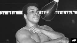 FILE - Muhammad Ali, world heavyweight champion, punches speed bag at the Folk Art Center in Manila, Philippines, Sept. 29, 1975, as he prepares his title fight on October 1 with Joe Frazier.