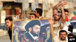 Ополченцы «Армии Махди» с портретом имама Муктады Садра