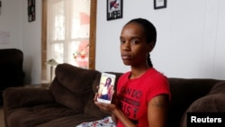 Brittany Osberry shows a picture of herself when she was pregnant with her son Kannon in her home in Lima, Ohio U.S., December 23, 2017.