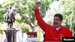 "Venezuela's President Nicolas Maduro gestures while he speaks during his weekly broadcast ""Los Domingos con Maduro"" (The Sundays with Maduro) in Caracas, Venezuela, July 23, 2017."