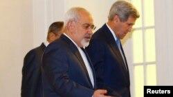 U.S. Secretary of State John Kerry talks to Iranian Foreign Minister Javad Zarif, left, before a meeting in Vienna, Austria, Nov. 24, 2014.