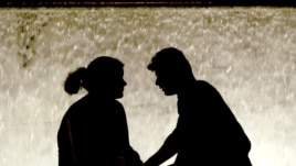 A couple in Athens' Syntagma Square