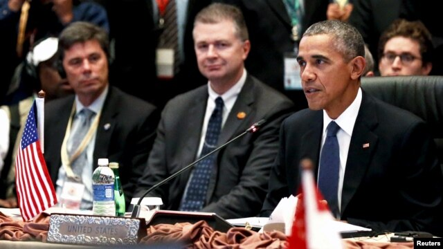 FILE - U.S. President Barack Obama, right, delivers remarks at the US-ASEAN meeting at the ASEAN Summit in Kuala Lumpur, Malaysia, Nov. 21, 2015.