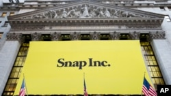 FILE - In this Thursday, March 2, 2017, file photo, a banner for Snap Inc. hangs from the front of the New York Stock Exchange, in New York. Chinese internet company Tencent buys a 10 percent stake in Snap, announced Wednesday, Nov. 8, 2017.