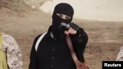 FILE - An Islamic State militant holdsa gun in this still image from an undated video made available on a social media website on April 19, 2015.
