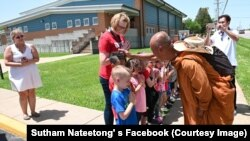 Children line up to meet and greet Buddhist monk Sutham Nateetong at Ziztman Elementary School during his journey walk across America to promote peace in Pacific, Missouri. May 22, 2019.