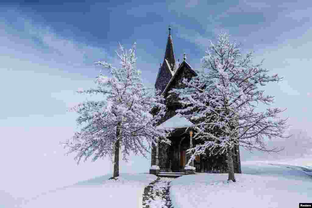 A snow-covered chapel is seen, after the first snowfall of the season, in the western Austrian village of Tulfes.