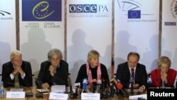 Members of the Parliamentary Assembly of the Organisation for Security and Cooperation in Europe (OSCE), led by Walburga Habsburg Douglas, center, attend news conference, Kiev, Oct. 29, 2012.