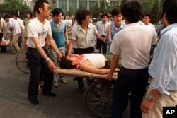 Local residents loaded the wounded people on a rickshaw flatbed shortly after PLA soldiers opened fire on a crowd in this June 4, 1989 photo.