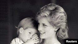 FILE - Britain's Princess Diana holds Prince Harry during a morning picture session at Marivent Palace, where the Prince and Princess of Wales are holidaying as guests of King Juan Carlos and Queen Sofia, in Mallorca, Spain August 9, 1988.