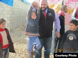 Mohamed Khairullah visits Atmah refugee camp in 2012. (Courtesy of Mohamed Khairullah)