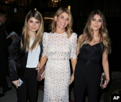 FILE - Actress Lori Loughlin, center, is seen with her daughters Isabella Rose Giannulli and Olivia Jade Giannulli in Los Angeles, Calif.