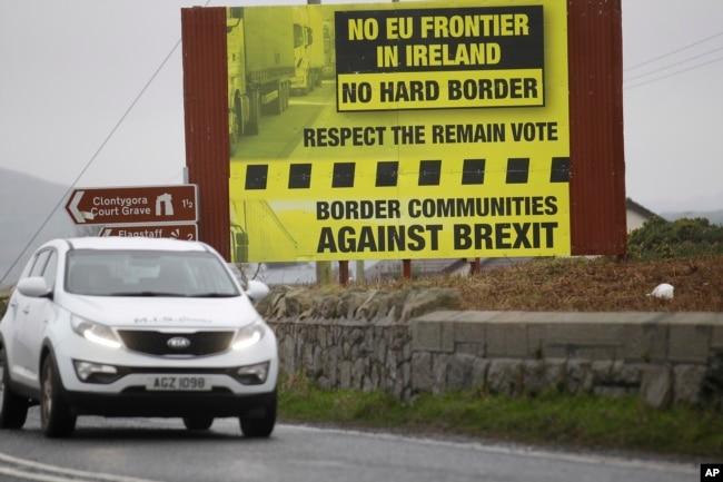 FILE - A motorist crosses over the border from the Irish Republic into Northern Ireland near the town of Jonesborough, Northern Ireland, Jan. 30, 2017.