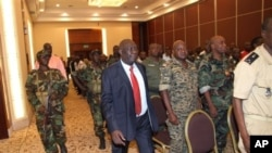 Michel Djotodia, center, rebel leader who declared himself president, arrives for meetings with government armed forces, Bangui, Central African Republic, March 28, 2013.