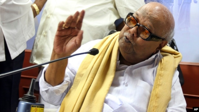 Leader of the Dravida Munnetra Kazhagam party M. Karunanidhi speaks at a press conference withdrawing support to India's ruling United Progressive Alliance government, at the party office in Chennai, India, March 19, 2013.