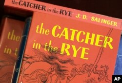 """FILE - Copies of J.D. Salinger's classic novel """"The Catcher in the Rye"""" are seen at the Orange Public Library in Orange Village, Ohio, Jan. 28, 2010."""