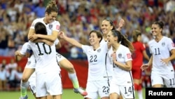 U.S. forward Kelley O'Hara leaps into a teammate's arms in celebration of her goal during the second half against Germany in the semifinals of the FIFA 2015 Women's World Cup at Olympic Stadium in Montreal, Quebec. (Credit: Jean-Yves Ahern-USA TODAY Sports)