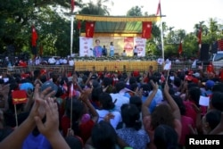 Myanmar pro-democracy leader Aung San Suu Kyi speaks during her campaign rally for the upcoming general elections in Toungup, Rahine state, October 16, 2015.