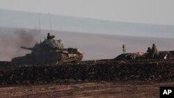 Leşkerên Tirk li ser tixubê Sûrîyê