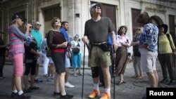 American tourists look around during a tour of old Havana, Cuba, Dec. 14, 2015.