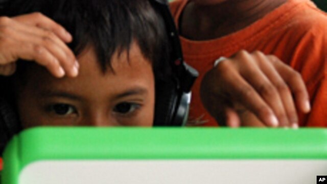 A child at a Phnom Penh orphanage focuses on playing the computer game, which requires him to find food in the Cambodian countryside while avoiding on-screen landmines.