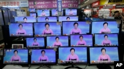 TV screens show a North Korean newscaster reading a statement from the North's Nuclear Weapons Institute during a news program at the Yongsan Electronic Market in Seoul, South Korea, Sept. 9, 2016.