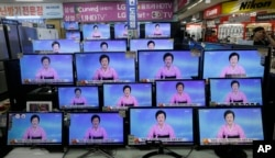 FILE - TV screens show a North Korean newscaster reading a statement from the North's Nuclear Weapons Institute during a news program at the Yongsan Electronic Market in Seoul, South Korea, Sept. 9, 2016.