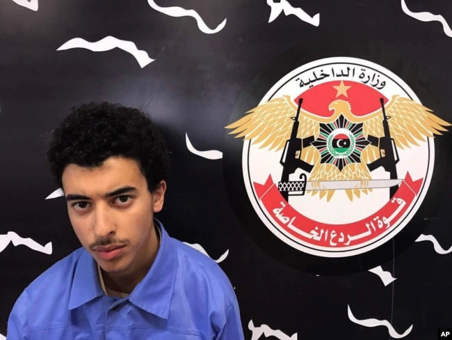 Hashim Ramadan Abedi appears inside the Tripoli-based Special Deterrent anti-terrorism force unit after his arrest on Tuesday for alleged links to the Islamic State extremist group, May 24, 2017.