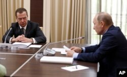 Russian President Vladimir Putin, right, meets with his Prime Minister Dmitry Medvedev, Moscow, Wednesday, July 5, 2017.