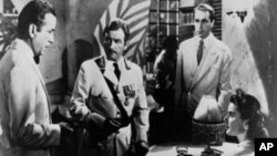 "A scene from the 1942 film ""Casablanca"" with Ingrid Bergman, lower right, Humphrey Bogart, far left, Claude Raines, center, and Paul Henreid, right background."