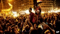 Egyptians gather to protest ongoing military rule in Tahrir Square in Cairo, Friday, June 15, 2012.