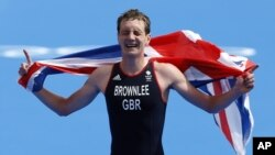 Great Britain's Alistair Brownlee reacts as he crosses the finish line to win the gold medal in the men's triathlon at the 2012 Summer Olympics, Aug. 7, 2012, in London.