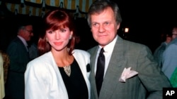 """FILE - This June 13, 1986 file photo shows actress Victoria Principal and actor Ken Kercheval, co-stars of the popular TV-show """"Dallas."""" Kercheval, who played Cliff Barnes on the hit TV series """"Dallas"""" has died at age 83."""