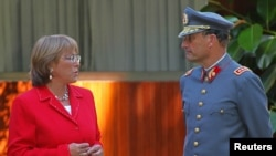 FILE - Juan Emilio Cheyre, then the chief of Chile's army, talks with Michelle Bachelet, then the country's president-elect, after a meeting in her house in Santiago, Jan. 17, 2006.