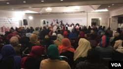 Members of the Somali-Canadian community discuss the issue of gang violence at a recent town hall meeting hosted by VOA's Somali Service, in Toronto, Canada.