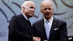 Sen. John McCain, R-Ariz., receives the Liberty Medal from Chair of the National Constitution Center's Board of Trustees, former Vice President Joe Biden in Philadelphia, Monday, Oct. 16, 2017.