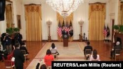 拜登总统在白宫东厅举行上任以来的首场正式记者会。(2021年3月25日)