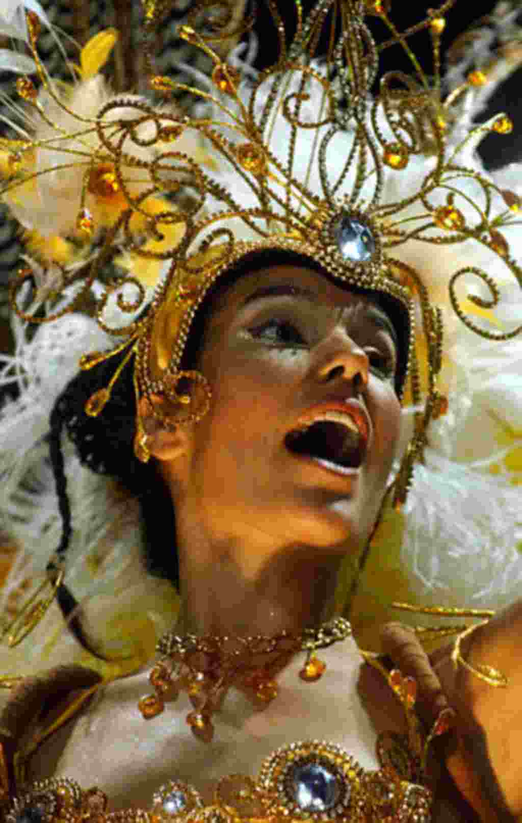 A dancer belonging to Ara Yevi masquerade group parades during the carnival in Gualeguaychu, some 230 km (142 miles) from Buenos Aires, Argentina, Sunday, Feb. 8, 2004. Gualeguaychu, a city in the province of Entre Rios,Argentina, is famous for its carniv