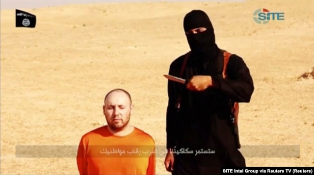 "FILE - ""Jihadi John"" stands next to a man purported to be Steven Sotloff in this still image from a video obtained from SITE Intel Group website, Feb. 26, 2015."